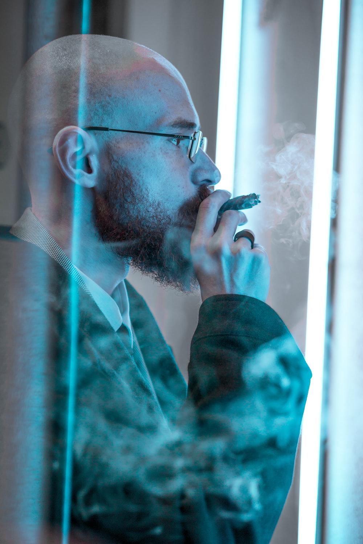 man smoking inside room