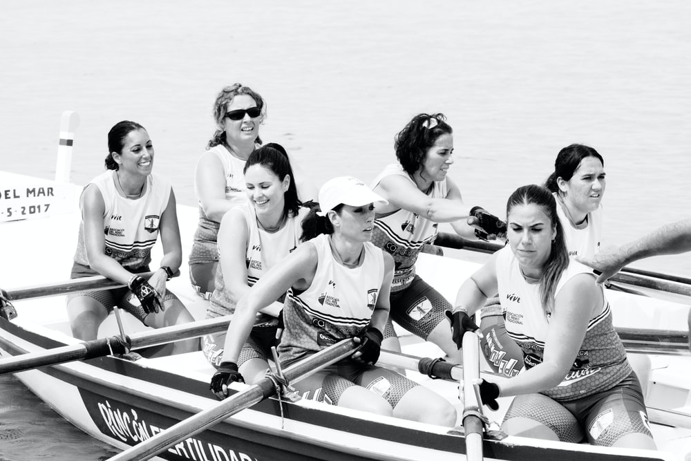grayscale photography of women in boat