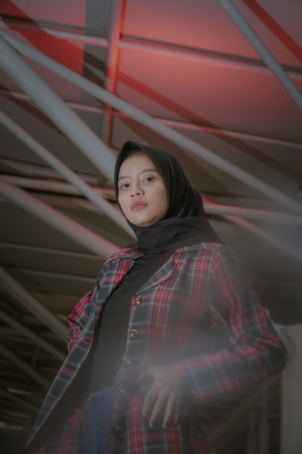 woman wearing red and black plaid coat