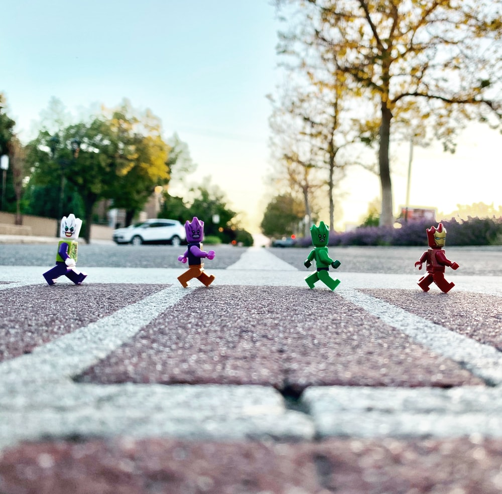 plastic toys on road on focus photography