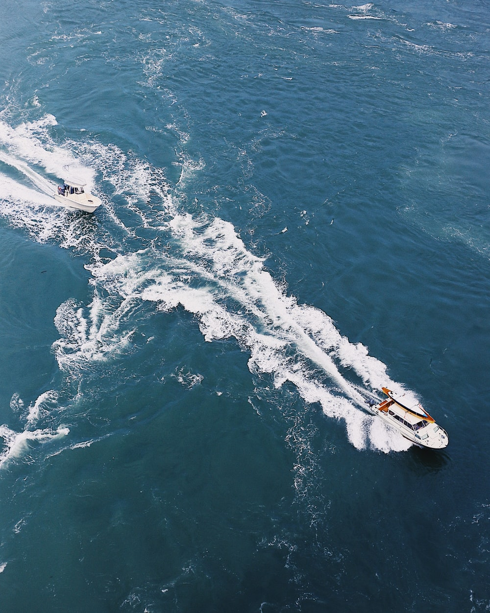 aerial photography of two boats on sea