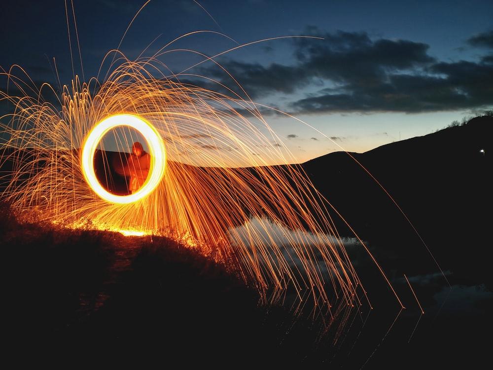 steel wool photography of man near outdoor