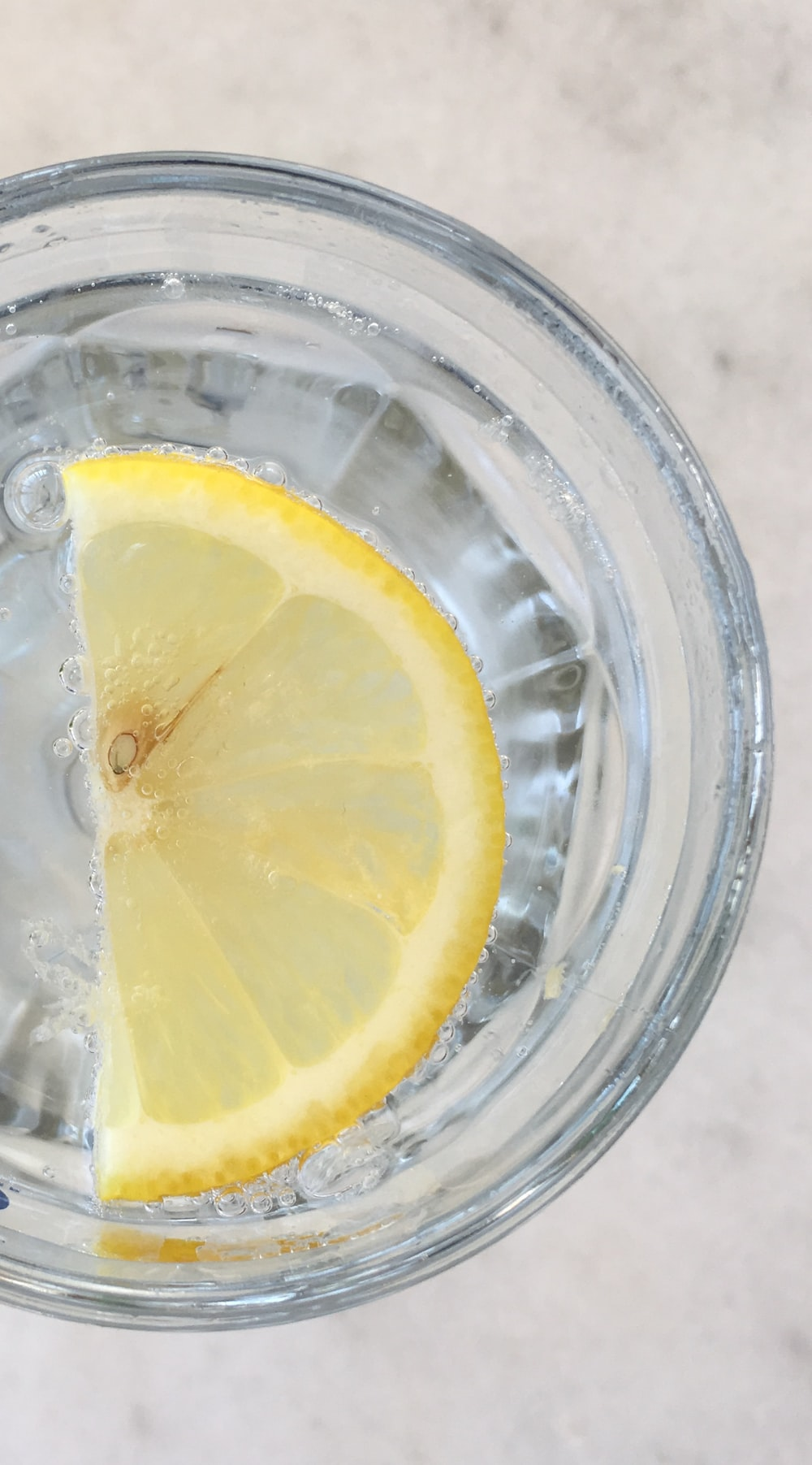 sliced lemon in drinking glass