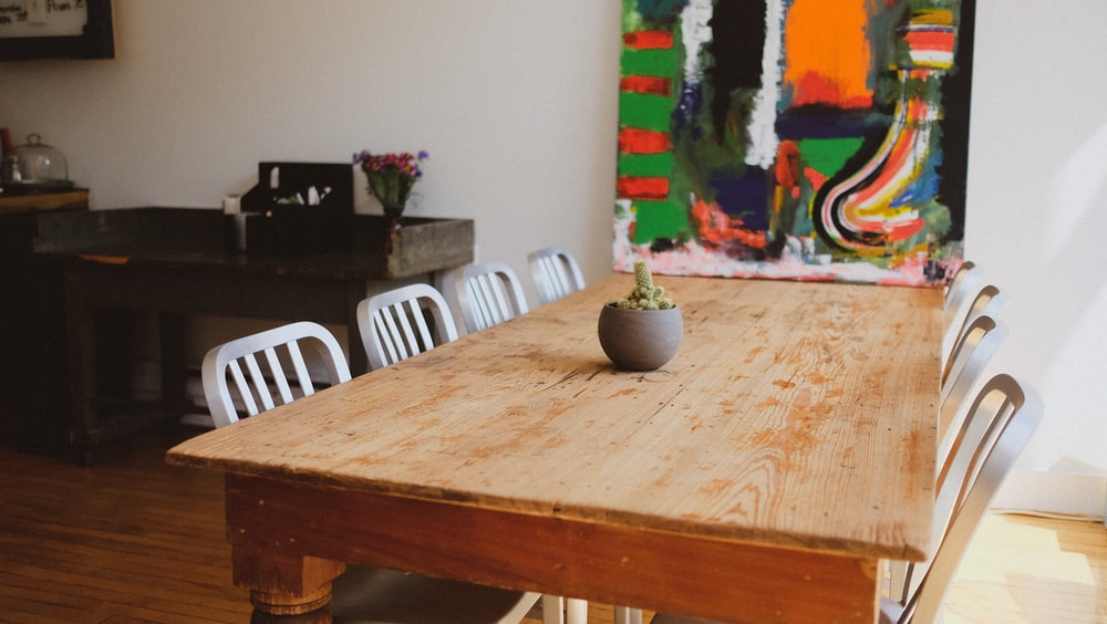 rectangular brown table with chairs set