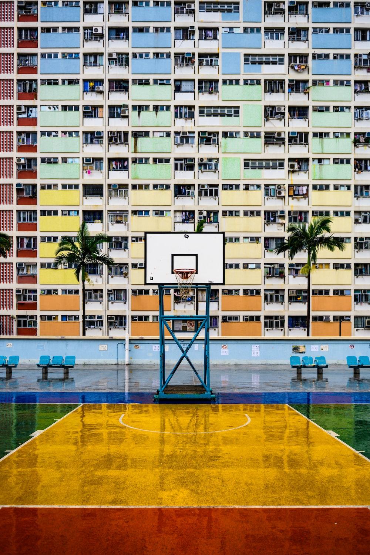 white basketball court beside building