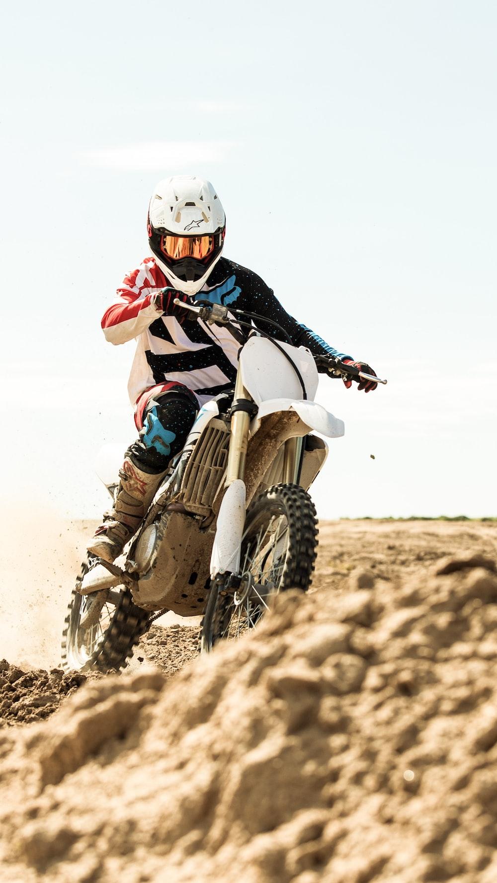 man riding motocross motorcycle