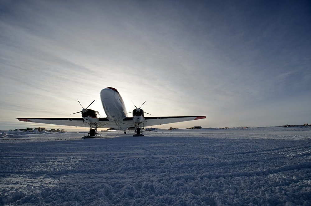 white airplane on runway during daytime