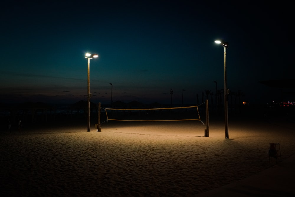 lighted lamp posts during nighttime