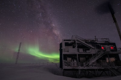 white multi-storey building under starry night and northern lights south sudan zoom background