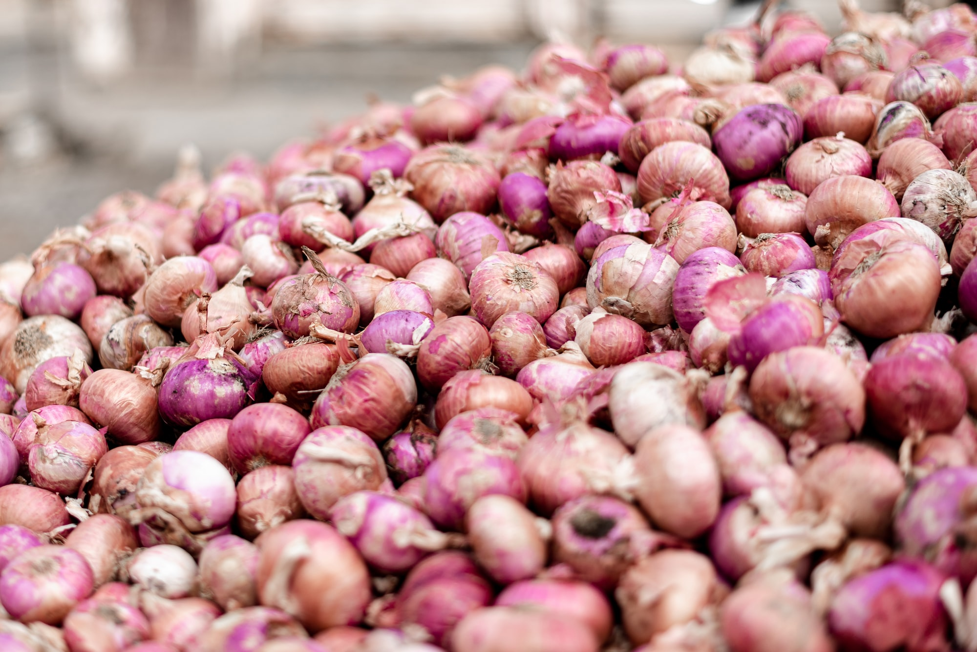 Sweat contains sulfurous molecules that can smell like onions and garlic by Varun Gaba for Unsplash.