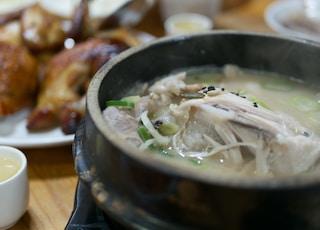 white soup on black ceramic pot