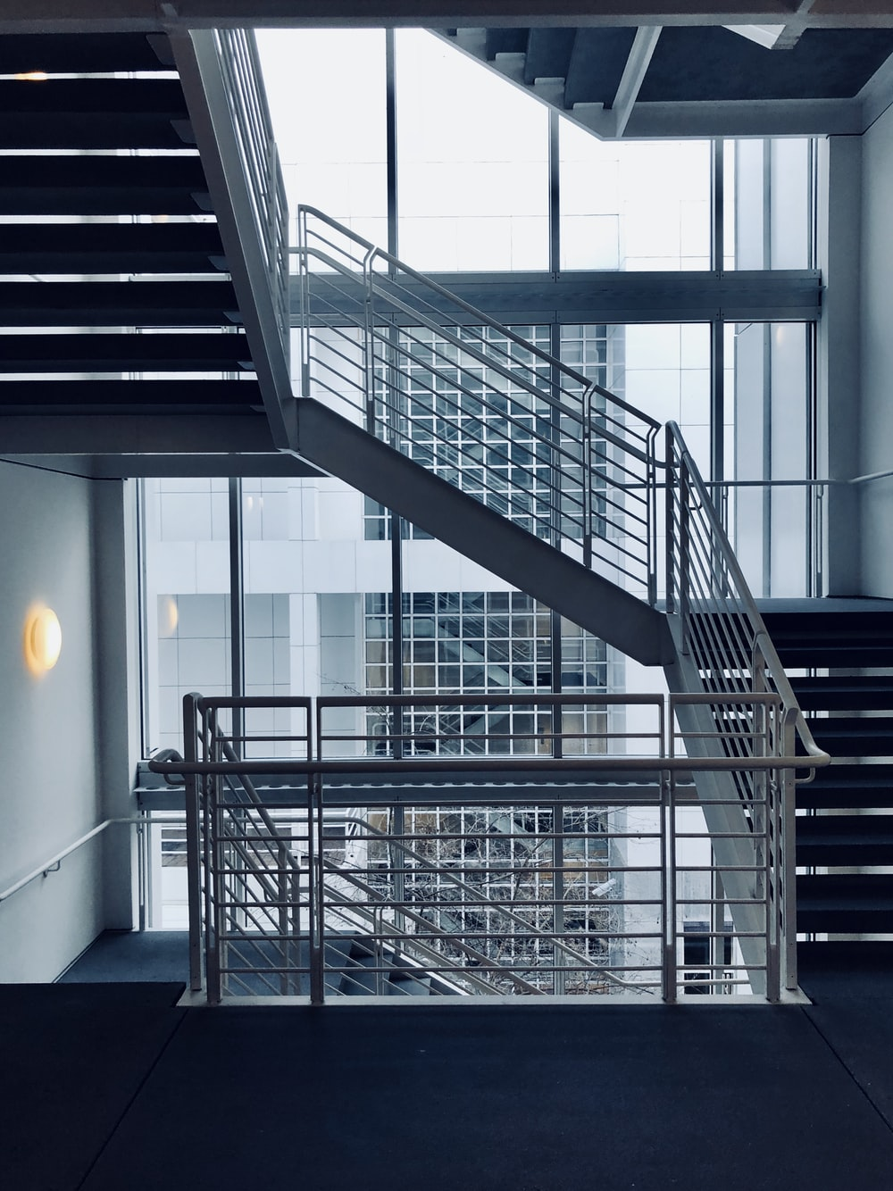 architectural photography of white stair handrail
