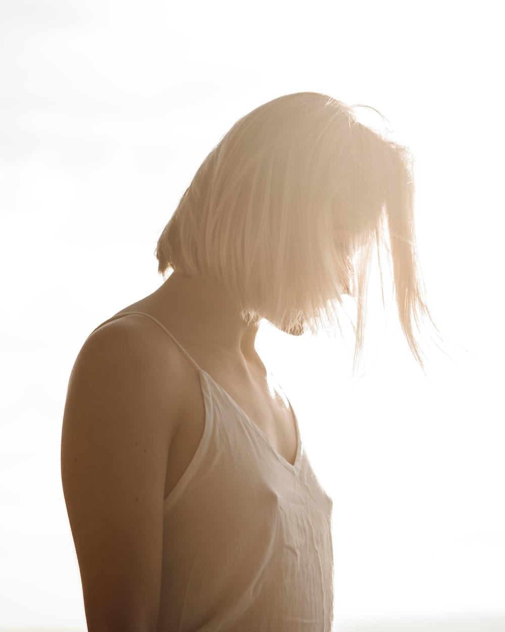 woman in white spaghetti strap top