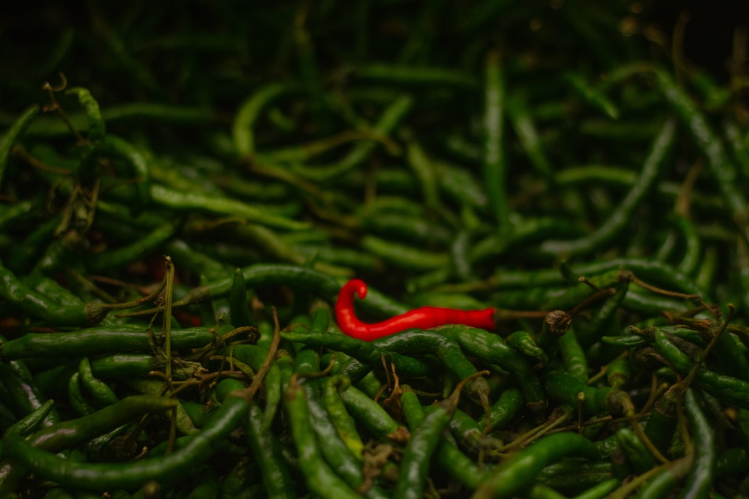 Stand Out.  Inspired by Charles Isidi  So Charles Isidi and I went to Shoprite and I spotted this red pepper sitting pretty with green ones. A thousand sermons ran through his head about nonconformity and all things in between.  Check it out, be blessed.