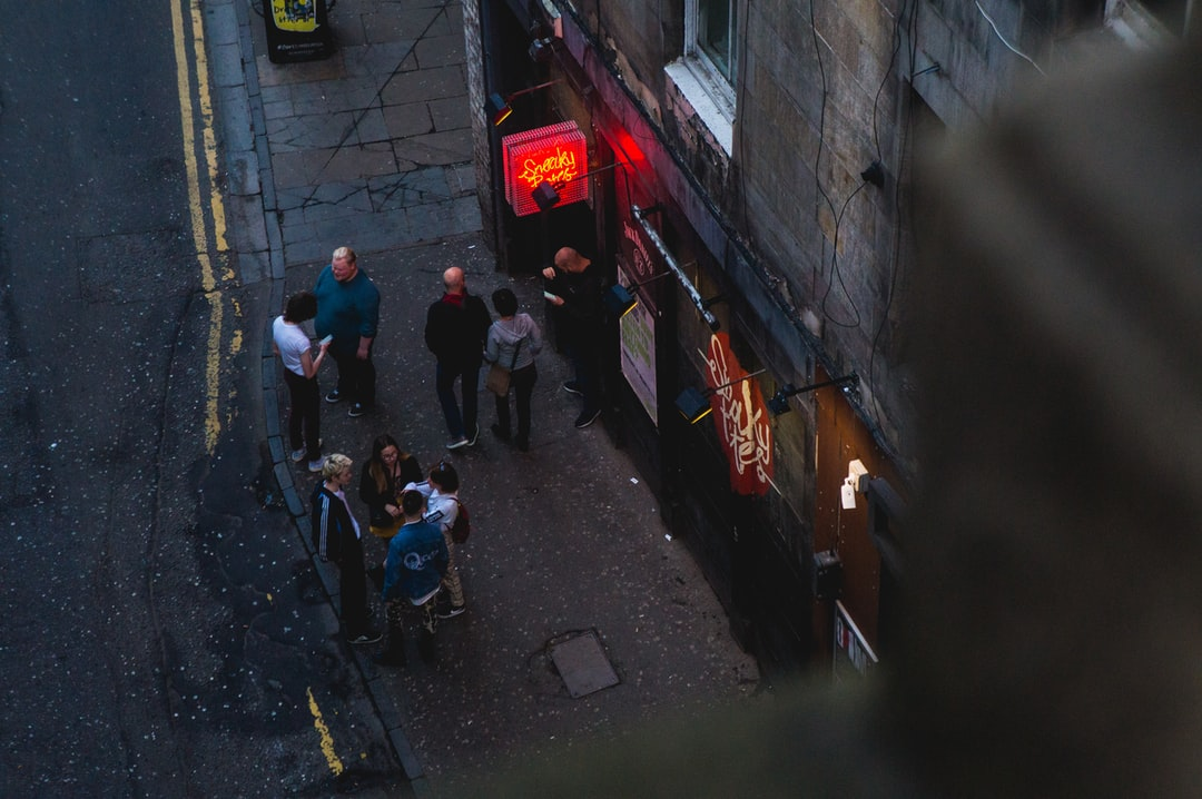 Group of people gathered outside a bar