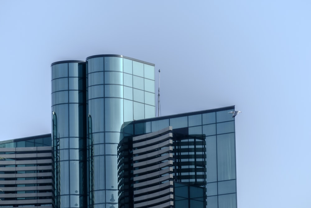 architectural photography of blue city building
