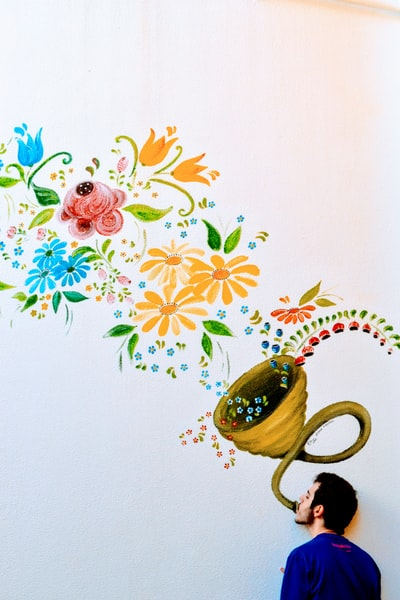 yellow, green, and blue petaled flower grafiti