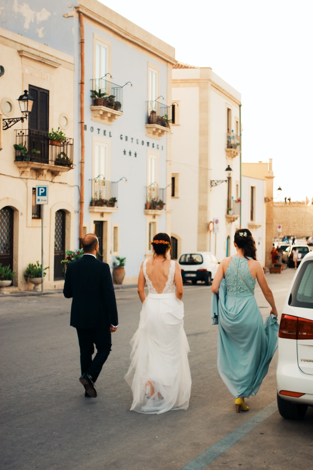 A summer wedding in Italy, newlywed couple bride and groom with bridesmaid