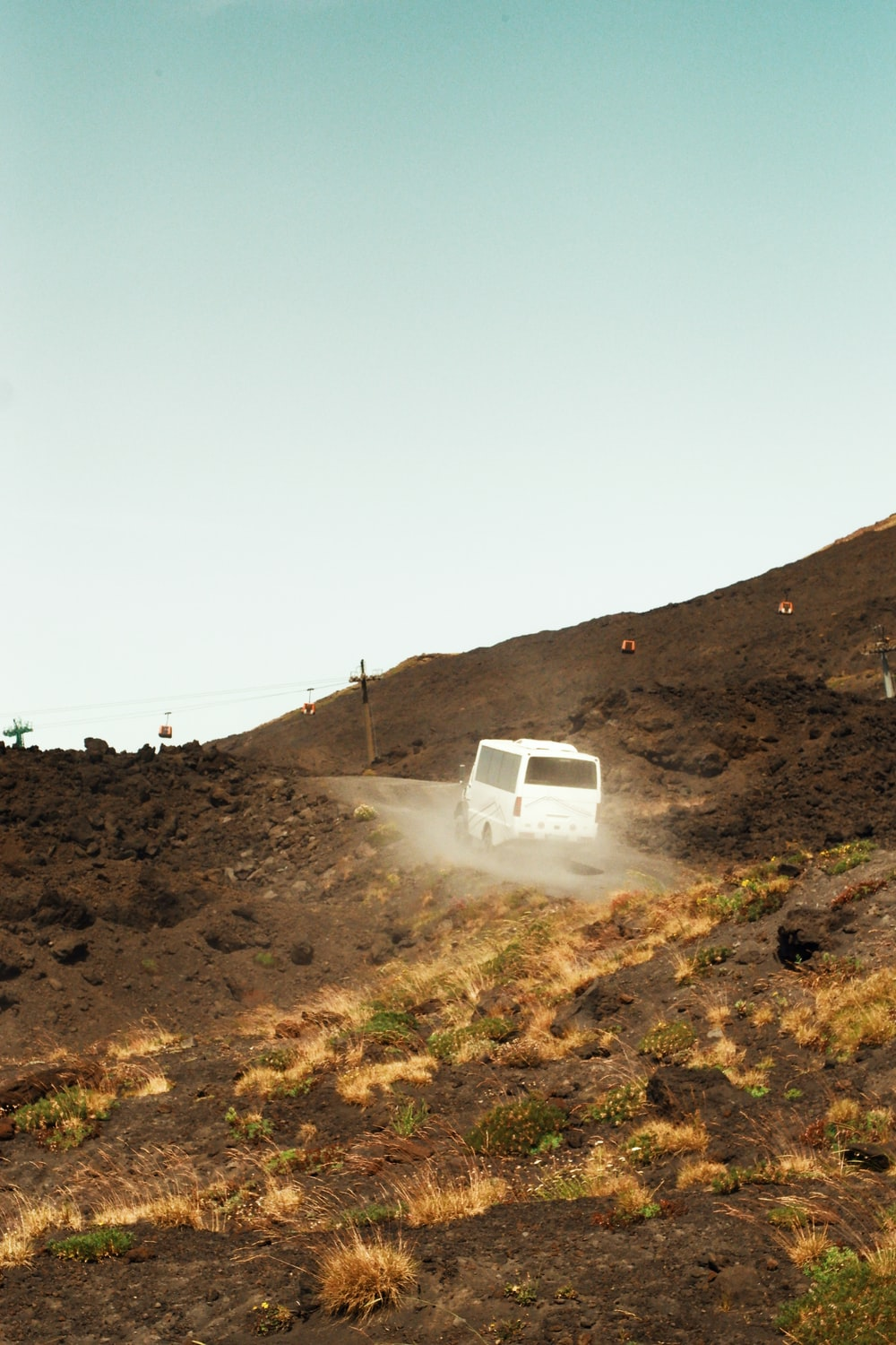 white van in a hill during daytime