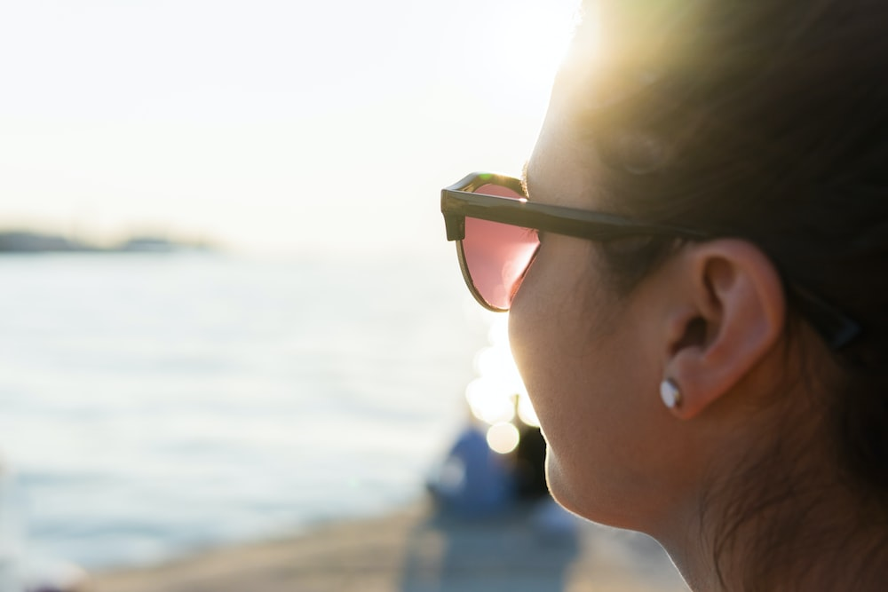 women wearing a sunglasses during daytime