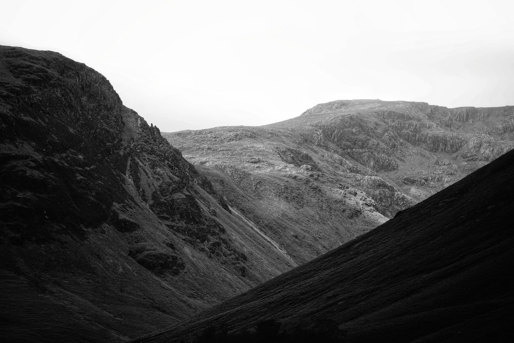 grayscale photo of gray mountains