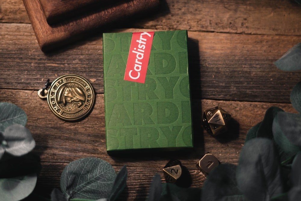 green Cardistry box on brown wooden surface