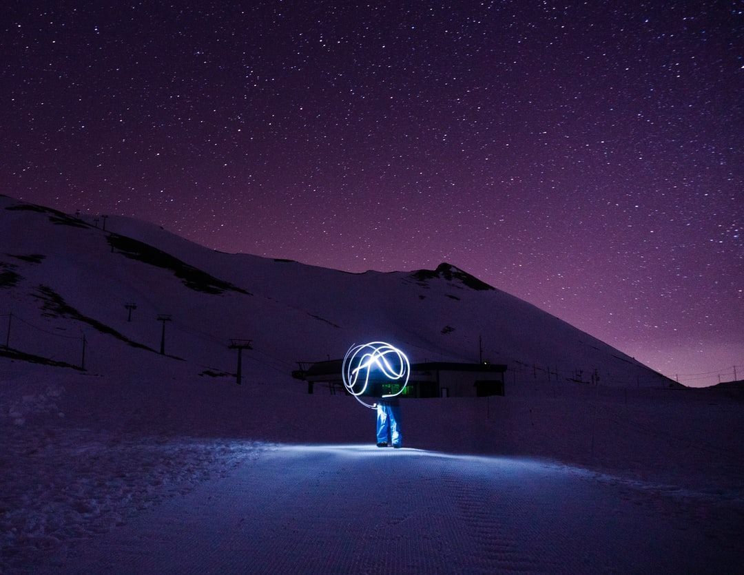 Light painting under the stars on mountain Falakro in Greece.