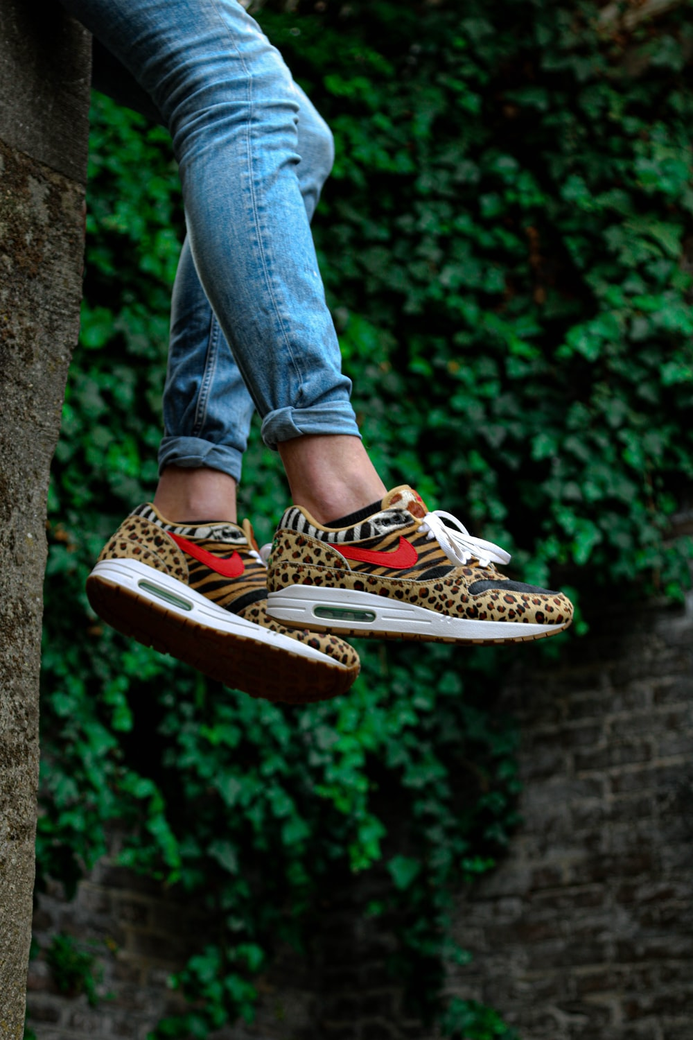person wearing leopard print sneakers