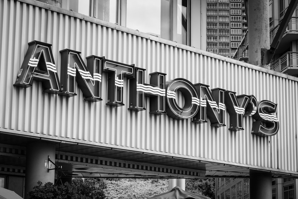 grayscale photo of Anthony's building