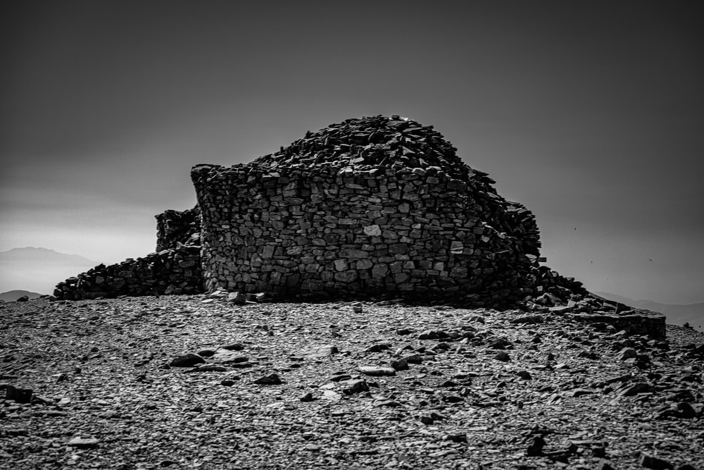grayscale photography of ruin building during daytime