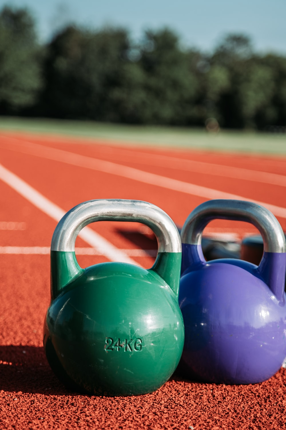 two green and purple kettle bells