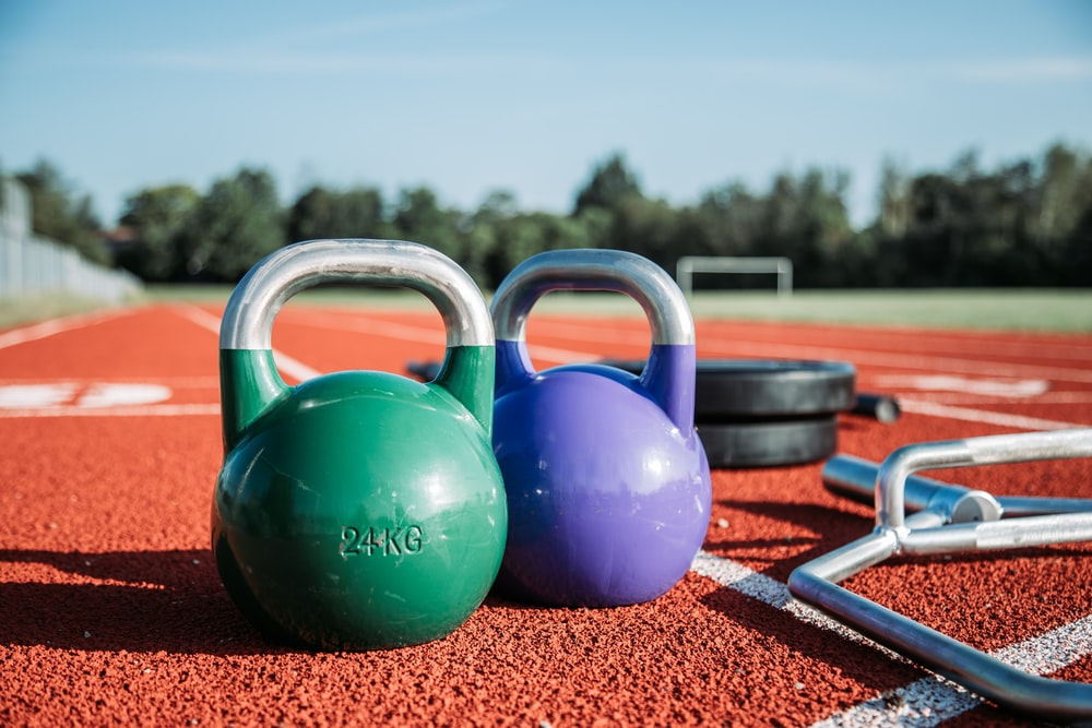 two green and purple kettlebells