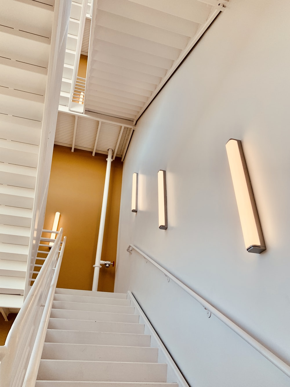 white painted wall and stairs close-up photography