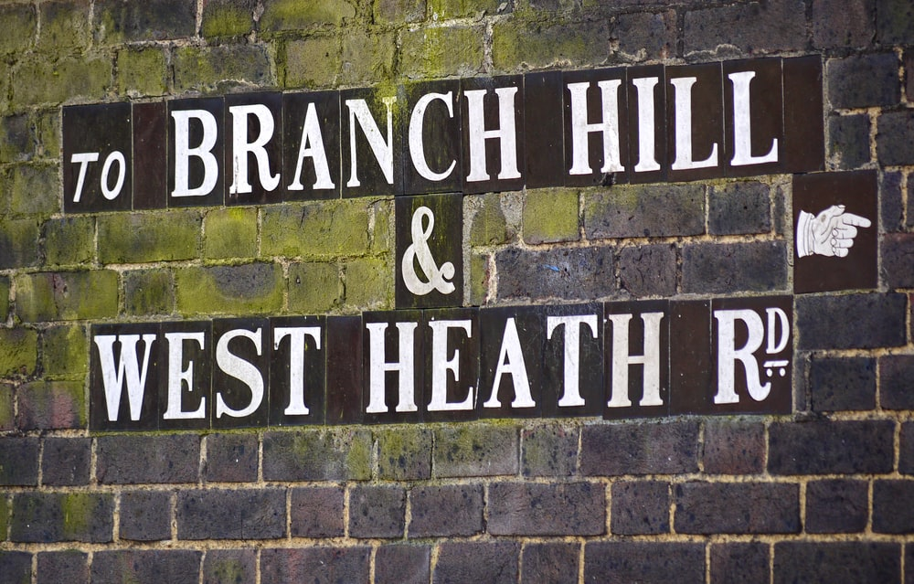 wall with to branch hill & west health road sign