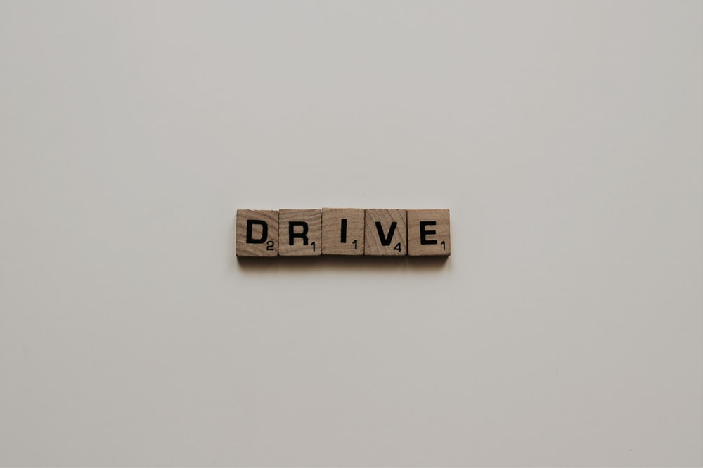 scrabble tiles spelling out drive word
