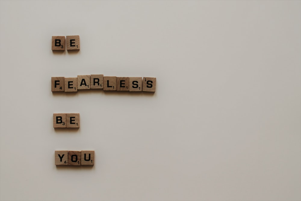 scrabble tiles forming be fearless be you phrase