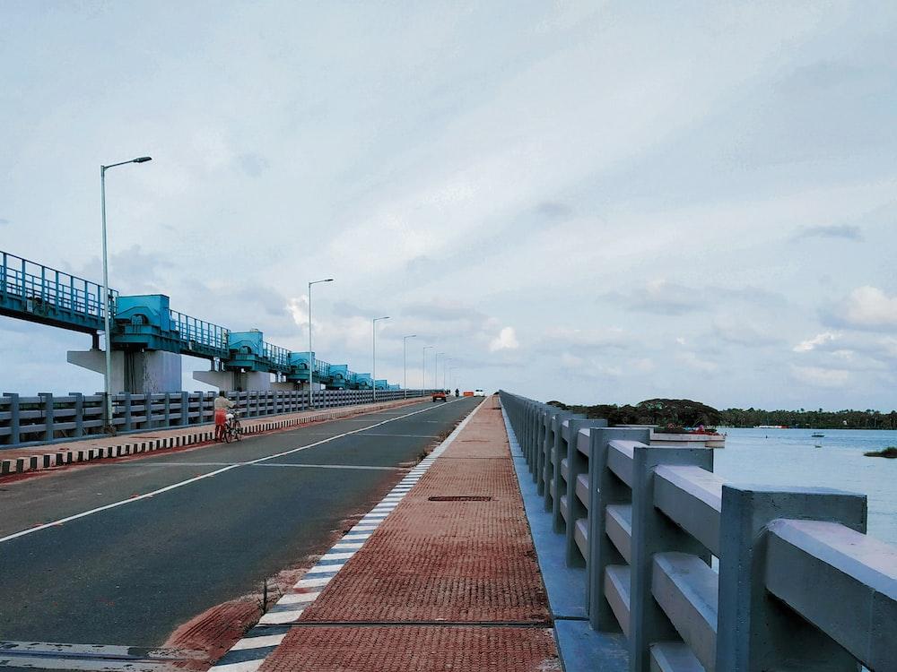 concrete bridge under blue sky