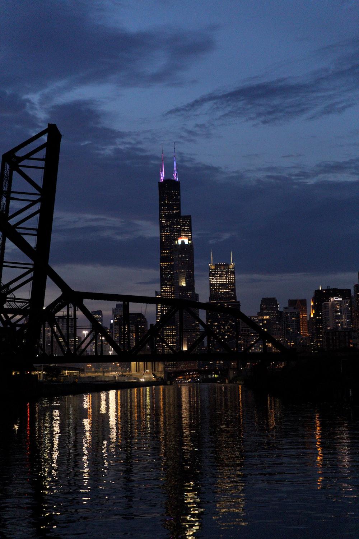 silhouette of bridge near buildings