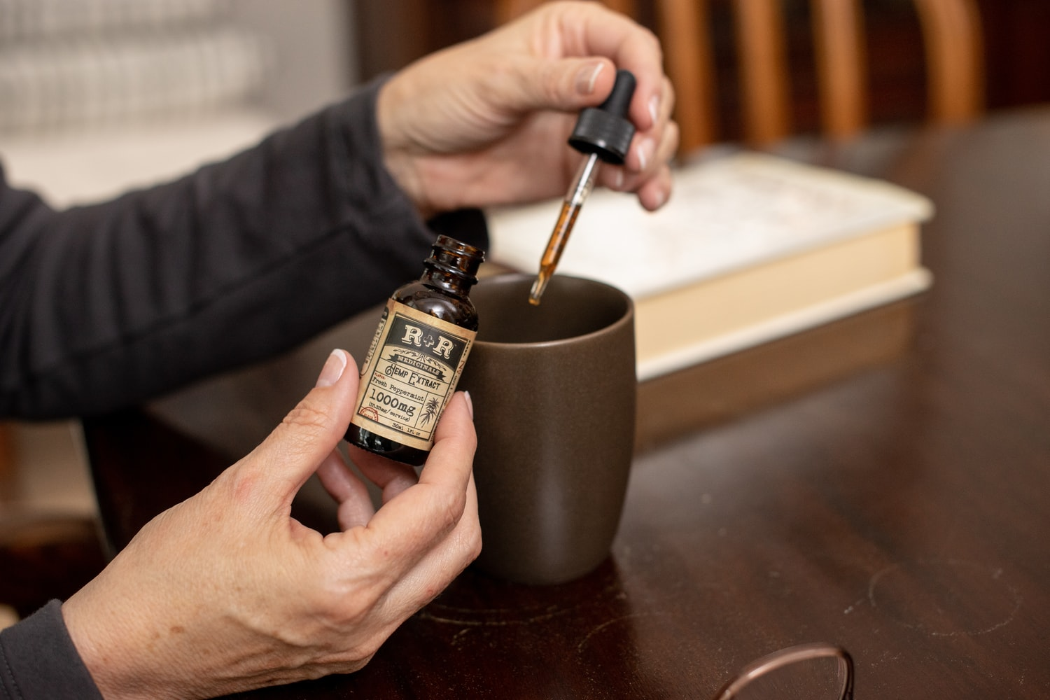 A person is holding a hemp oil