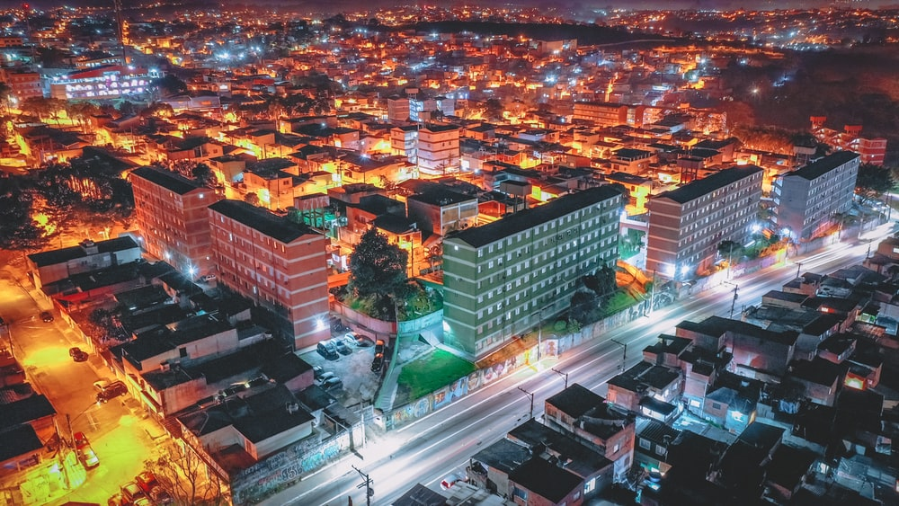 aerial view of lighted buildings at night