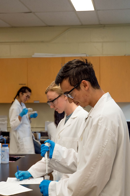 man in white lab coat