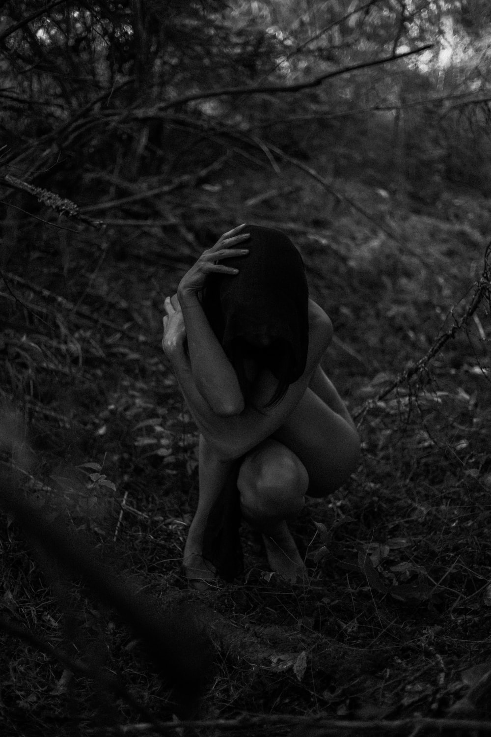 grayscale photography of woman naked outdoor