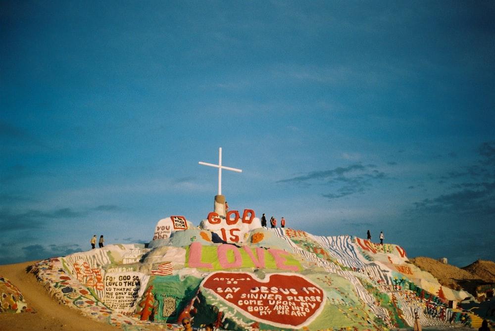 god is love mountain under blue sky