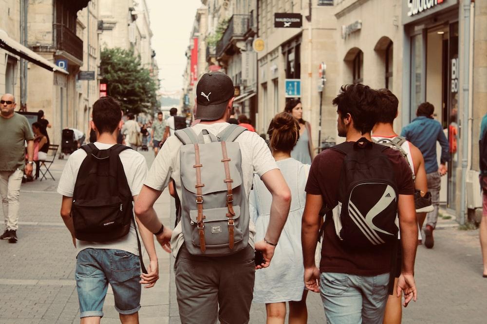 group of people walking on street during daytime