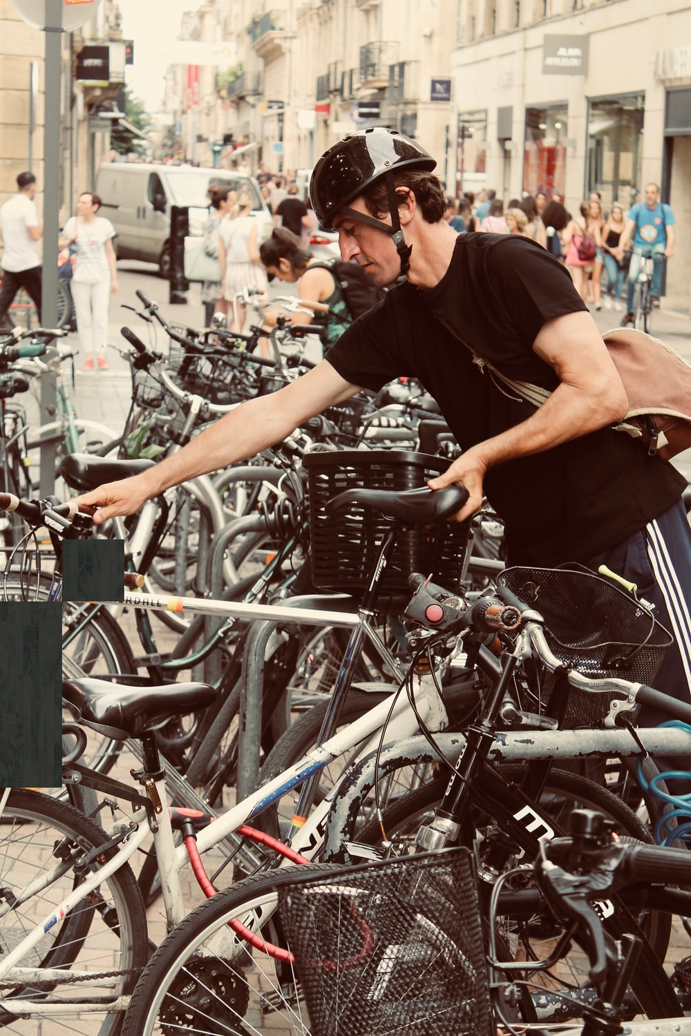 man holding black and gray bicycle close-up photography