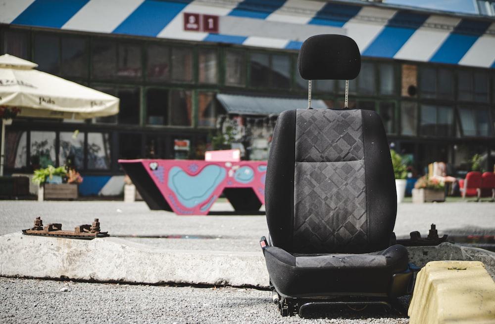 black car bucket seat on concrete floor