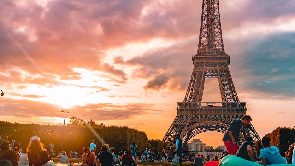 people standing near Eiffel tower