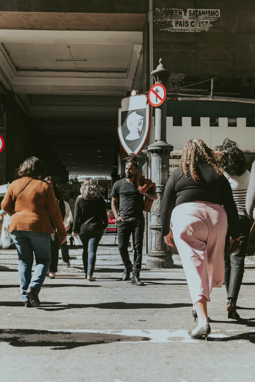 people walking in a road during daytime