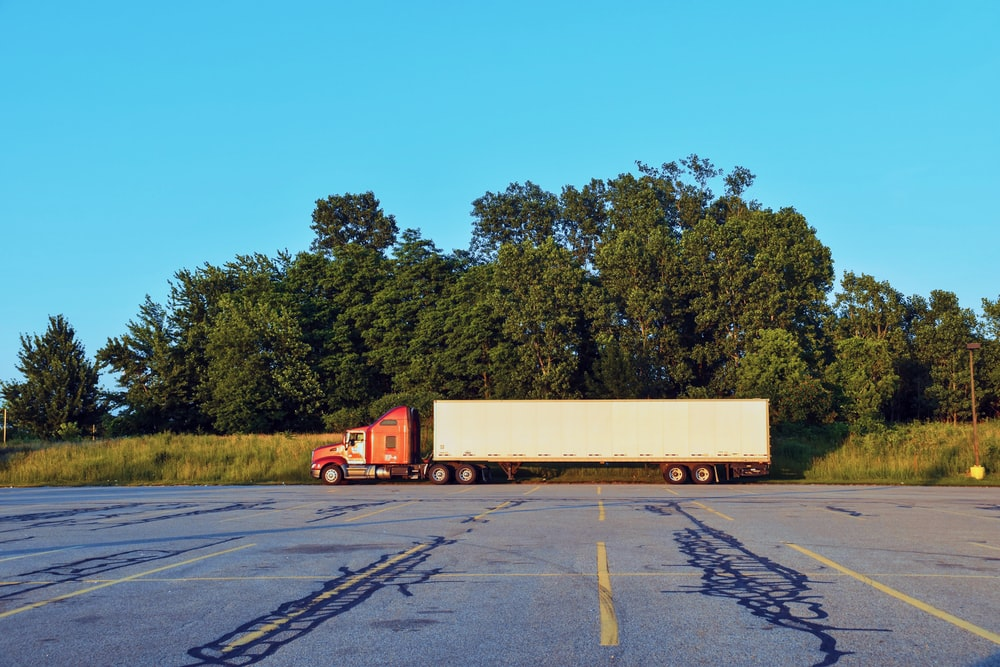red and white freight truck