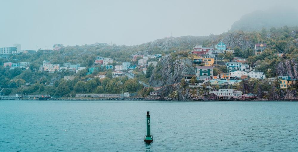houses near sea viewing mountain